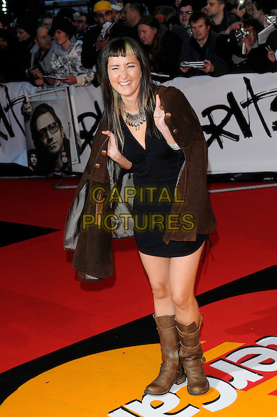 KT TUNSTALL aka Kate Victoria Tunstall .Arrivals - 2009 Brit Awards, Earls Court, London, England, February 18th 2009..brits full length black dress brown boots jacket blunt fringe biker silver necklace .CAP/FIN.©Steve Finn/Capital Pictures