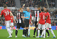 Referee Mike Dean shows a yellow card to Scott McTominay of Man Utd during the Premier League match between Newcastle United and Manchester United at St. James's Park, Newcastle, England on 6 October 2019. Photo by J GILL / PRiME Media Images.