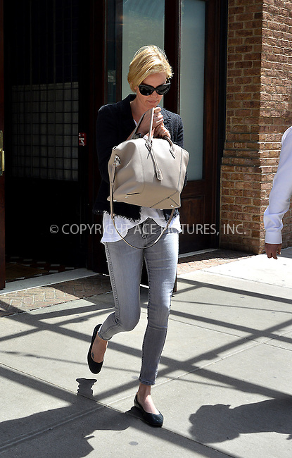 WWW.ACEPIXS.COM<br /> <br /> May 7 2014, New York City<br /> <br /> Actress Charlize Theron leaves a downtown hotel on May 7 2014 in New York City<br /> <br /> By Line: Curtis Means/ACE Pictures<br /> <br /> <br /> ACE Pictures, Inc.<br /> tel: 646 769 0430<br /> Email: info@acepixs.com<br /> www.acepixs.com