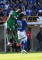 BOGOTA - COLOMBIA - 07 -03-2015: Fernando Uribe (Der.) jugador de Millonarios disputa el balón con Yonatan Murillo (Izq.) jugador de La Equidad, durante partido entre Millonarios y La Equidad por la fecha 8 de la Liga Aguila I-2015, jugado en el estadio Nemesio Camacho El Campin de la ciudad de Bogota. / Fernando Uribe (R) player of Millonarios vies for the ball with Yonatan Murillo (L) player of La Equidad, during a match between Millonarios and La Equidad for the  date 8 of the Liga Aguila I-2015 at the Nemesio Camacho El Campin Stadium in Bogota city, Photo: VizzorImage / Luis Ramirez / Staff.