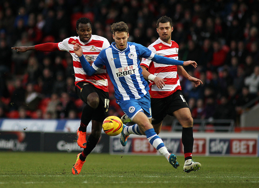 Wigan Athletic's Nick Powell vies for possession with Doncaster Rovers' Bongani Khumalo (left)<br /> <br /> Photo by Rich Linley/CameraSport<br /> <br /> Football - The Football League Sky Bet Championship - Doncaster Rovers v Wigan Athletic - Saturday 18th January 2014 - Keepmoat Stadium - Doncaster<br /> <br /> &copy; CameraSport - 43 Linden Ave. Countesthorpe. Leicester. England. LE8 5PG - Tel: +44 (0) 116 277 4147 - admin@camerasport.com - www.camerasport.com