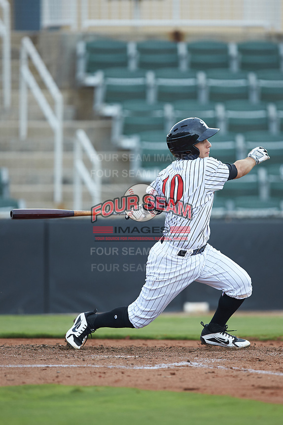 Nick Madrigal (10) of the Kannapolis Intimidators follows through on his swing against the West Virginia Power at Kannapolis Intimidators Stadium on July 25, 2018 in Kannapolis, North Carolina. The Intimidators defeated the Power 6-2 in 8 innings in game one of a double-header. (Brian Westerholt/Four Seam Images)