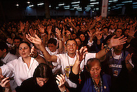Worshippers at a service by Brazil's charismatic Padre Marcelo Rossi are encouraged to sing, shout and speak in tongues much like their Pentecostal counterparts, yet Catholic traditions, such as communion are preserved.