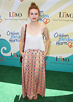 "BEVERLY HILLS, CA, USA - JUNE 14: Holland Roden at the Children Mending Hearts' 6th Annual Fundraiser ""Empathy Rocks: A Spring Into Summer Bash"" on June 14, 2014 in Beverly Hills, California, United States. (Photo by Celebrity Monitor)"