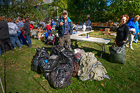 Don Wolfe stands with a collection of black garbage bags he bought at an estate auction.<br /> <br /> The contents of a home on East Broadway went before the auction block Saturday. <br /> <br /> Eager bargain hunters took their time looking over prospective purchases hoping others didn't know of its true value or weren't interested in their item of choice.<br /> <br /> Many boxed items were sold with the buyer only interested in one item in the box of interest. Many buyers bought large lots of glass and pottery for a single knickknack in the collection.