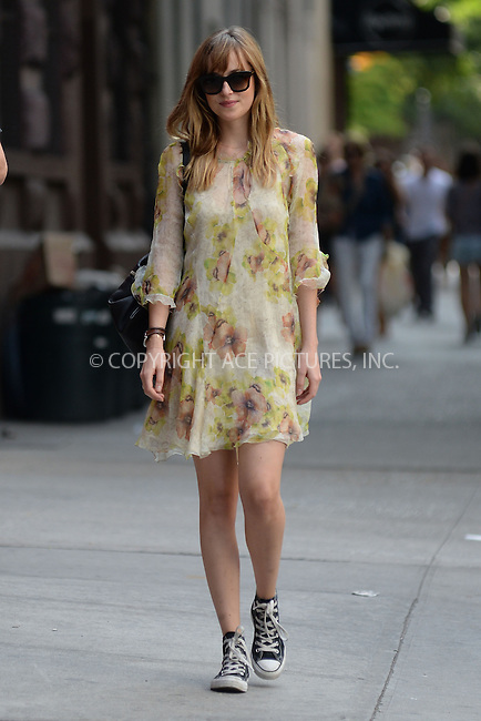 WWW.ACEPIXS.COM<br /> July 25, 2014 New York City<br /> <br /> Dakota Johnson out and about on the Lower East Side of New York City on July 25, 2014.<br /> <br /> By Line: Kristin Callahan/ACE Pictures<br /> ACE Pictures, Inc.<br /> tel: 646 769 0430<br /> Email: info@acepixs.com<br /> www.acepixs.com