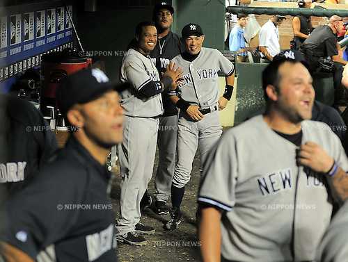 (L-R) Robinson Cano, Ichiro Suzuki (Yankees),<br /> JULY 23, 2013 - MLB :<br /> Robinson Cano and Ichiro Suzuki of the New York Yankees react in the dugout during the Major League Baseball game against the Texas Rangers at Rangers Ballpark in Arlington in Arlington, Texas, United States. (Photo by AFLO)