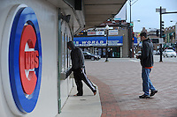 Young men check to see about available tickets at the ticket window near the entrance to Wrigley Field, a Chicago landmark, in Chicago, Illinois on March 23, 2009.