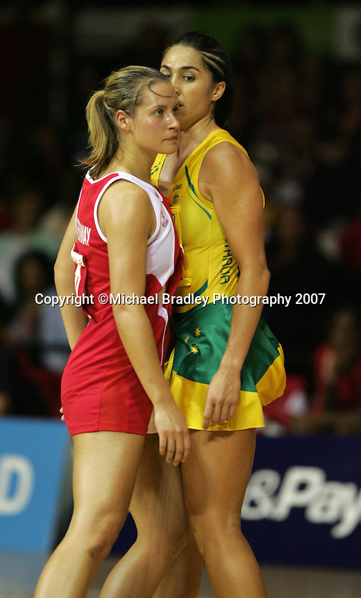 16.11.2007 England's Tamsin Greenway and Australian Mo'onia Gerrard in action during the Australia v England match at the New World Netball World Champs held at Trusts Stadium Auckland New Zealand. Mandatory Photo Credit ©Michael Bradley.