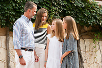 King of Spain Felipe VI, Queen of Spain Letizia and their daughters Princess of Asturias, Leonor and Princess Sofia pose at Marivent Palace gardens for media.