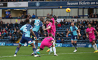 Adebayo Akinfenwa of Wycombe Wanderers heads a shot at goal during the Sky Bet League 2 match between Wycombe Wanderers and Hartlepool United at Adams Park, High Wycombe, England on 26 November 2016. Photo by Andy Rowland / PRiME Media Images.