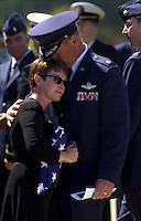 Dina Velkov, mother of 2nd Lt. Alex Velkov, is comforted by a liaison officer whom Pensacola Naval Air Station could not identify Saturday. _ MICHAEL SPOONEYBARGER/News Journal photo..Dina Velkov mother of 2nd Lt. Alex Velkov, is comforted (public affairs said by the Air Force Liason Officer) following the Training Squadron Ten Memorial Service for Lt. James Scott McComber and 2nd Lt. Alex Velkov at the Naval Air Station Pensacola Memorial Chapel. The two pilotswere killed when their plane went down Wednesday afternoon near Robertsdale Ala..\fp\\b0\\i0\\fs10\--------------------------------.\fp\\i0\\b\\fs16\Copyright 2000 Pensacola News Journal..\fp\\b0\\i0\\fs10\Copyright=Yes; Year=2000; Month=9; Month=Sep; Day=30; Day=Sa; Photographer=Michael_Spooneybarger; Person=Dina_Velkov; ..Aspect=Local:Staff; Aspect=30.09.2000; Aspect=Color; Aspect=Yes; Aspect=2000; Aspect=9; Aspect=Sep; Aspect=30; Aspect=Sa; Aspect=Michael_Spooneybarger; Aspect=Dina_Velkov;