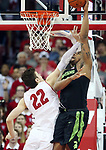 Wisconsin forward Ethan Happ (22) tries to keep Michigan State forward Nick Ward from scoring.