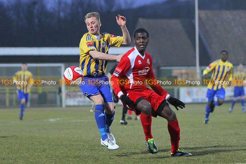 Ben Jones of Romford tussles with Rimmel Daniel of Tilbury - Romford vs Tilbury - Ryman League Division One North Football at Ship Lane, Thurrock FC - 10/04/13 - MANDATORY CREDIT: Gavin Ellis/TGSPHOTO - Self billing applies where appropriate - 0845 094 6026 - contact@tgsphoto.co.uk - NO UNPAID USE.