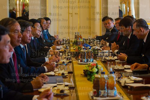 Truong Tan Sang (4th L) president of Vietnam and his Hungarian counterpart Janos Ader (2nd R) talk during their meeting in Budapest, Hungary on September 16, 2013. ATTILA VOLGYI<br /> Truong Tan Sang and his wife are on a three day visit in Hungary.