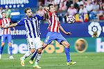 Deportivo Alaves's Alexis Ruano and Atletico de Madrid's Tiago Mendes during the match of La Liga Santander between Atletico de Madrid and Deportivo Alaves at Vicente Calderon Stadium. August 21, 2016. (ALTERPHOTOS/Rodrigo Jimenez)