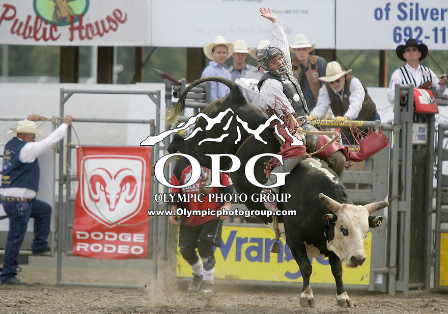 29 Aug 2010: Tag Elliott scored a 78.5 while riding the bull Tuxedo Kid during the first round of the Seminole Hard Rock Extreme Bulls competition at the Kitsap County Stampede in Bremerton, Washington.