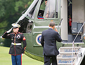 United States President Barack Obama salutes the Marine Guard as he prepares to board Marine 1 to depart the South Lawn of the White House in Washington, D.C. for a 2 day trip to Arizona and California.<br /> Credit: Ron Sachs / Pool via CNP