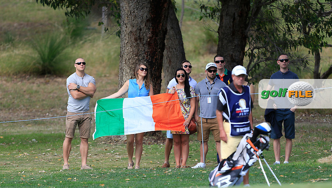 Damien McGrane (IRL). His sister Rois&iacute;n and friends sporting an Irish flag on the 11th during Round 4 of the ISPS HANDA Perth International at the Lake Karrinyup Country Club on Sunday 26th October 2014.<br /> Picture:  Thos Caffrey / www.golffile.ie