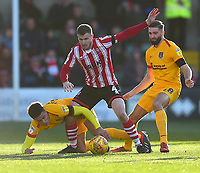 Lincoln City's Michael O'Connor battles with Northampton Town's Shaun McWilliams, left, and Jordan Turnbull<br /> <br /> Photographer Andrew Vaughan/CameraSport<br /> <br /> The EFL Sky Bet League Two - Lincoln City v Northampton Town - Saturday 9th February 2019 - Sincil Bank - Lincoln<br /> <br /> World Copyright &copy; 2019 CameraSport. All rights reserved. 43 Linden Ave. Countesthorpe. Leicester. England. LE8 5PG - Tel: +44 (0) 116 277 4147 - admin@camerasport.com - www.camerasport.com