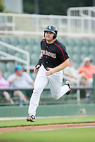 Mason Robbins (10) of the Kannapolis Intimidators hustles towards home plate against the Lakewood BlueClaws at Intimidators Stadium on July 14, 2015 in Kannapolis, North Carolina.  The Intimidators defeated the BlueClaws 8-2.  (Brian Westerholt/Four Seam Images)