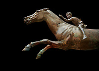 'Jockey of Artrmision' a Hellenistic bronze statue of a boy riding a horse. National Archaeological Museum Athens. Circa 140 BC. Cat No X 15177<br /> <br /> Retrieved in pieces from a shipwreck of Cape Artemision in Euboea. The young jockey holds a rein in his left hand and a whip in his right. His face has a passionate expression with furrowas on his face. The pieces of the Bronze sculpture were reassembled in 1971.