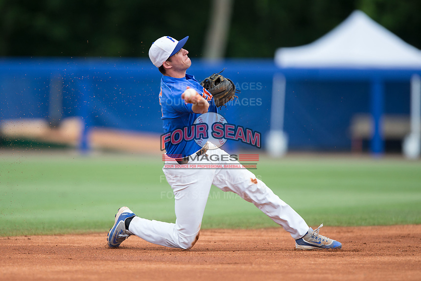 Florida Gators shortstop Dalton Guthrie (5) makes a throw to first base from his knee during the game against the Wake Forest Demon Deacons in Game Three of the Gainesville Super Regional of the 2017 College World Series at Alfred McKethan Stadium at Perry Field on June 12, 2017 in Gainesville, Florida. The Gators defeated the Demon Deacons 3-0 to advance to the College World Series in Omaha, Nebraska. (Brian Westerholt/Four Seam Images)
