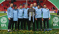 Manchester City manager Josep Guardiola with the trophy and his backroom team <br /> <br /> Photographer Rob Newell/CameraSport<br /> <br /> The Carabao Cup Final - Chelsea v Manchester City - Sunday 24th February 2019 - Wembley Stadium - London<br />  <br /> World Copyright © 2018 CameraSport. All rights reserved. 43 Linden Ave. Countesthorpe. Leicester. England. LE8 5PG - Tel: +44 (0) 116 277 4147 - admin@camerasport.com - www.camerasport.com