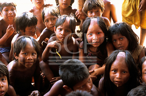 Bacaja village, Amazon, Brazil. Group of children, shaved head watching the photographer inquistively; Xicrin tribe.
