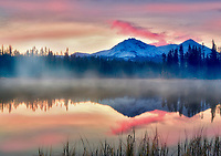 Sunrise on Scott Lake with North and Middle Sister Mountain. Central Oregon