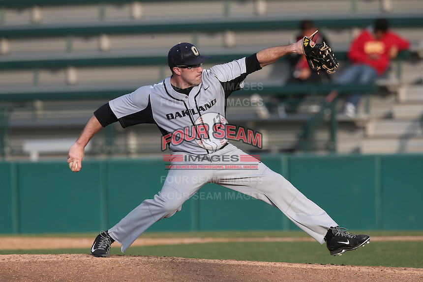 Doug Beath (13) of the Oakland Grizzlies pitches during a game against the Southern California Trojans at Dedeaux Field on February 21, 2015 in Los Angeles, California. Southern California defeated Oakland, 11-1. (Larry Goren/Four Seam Images)