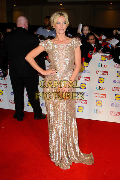 Sarah Harding<br /> The Daily Mirror's Pride of Britain Awards arrivals at the Grosvenor House Hotel, London, England.<br /> 7th October 2013<br /> full length dress silver gold hand on hip sequins sequined <br /> CAP/CJ<br /> &copy;Chris Joseph/Capital Pictures