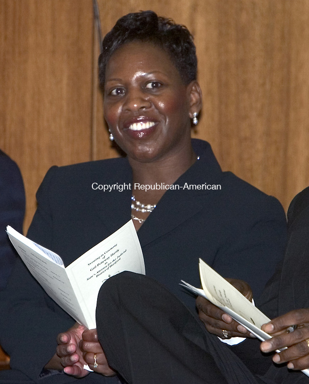 HARTFORD, CT. 10 August 2007-081007SV02--Gail Petteway Hardy of Waterbury, Hartford's new state's attorney, listens to speeches during a ceremony swearing her in at the appellate court on Elm Street in Hartford Friday. Hardy is the first women state&rsquo;s attorney in Hartford and the first black state's attorney in the states history.<br /> Steven Valenti Republican-American