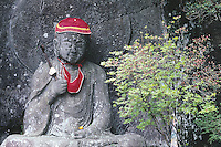 Statues of Jizo are found at thousands of temples and on waysides all over Japan. Jizo is the guardian bosatsu (or, in more normal Buddhist parlance, boddhisattva) for anyone who is suffering, and especially sick children and pregnant women. Bibs and hats are placed on the status by bereaved mothers and other sufferers.