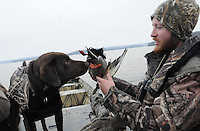 NWA Democrat-Gazette/FLIP PUTTHOFF<br /> Russell Gardner and his retriever, Gunner, look at a mallard drake, one of the ducks taken during a morning hunt Thursday Jan. 21, 2016 at Beaver Lake. Gardner has had a good season hunting ducks and geese at the lake.