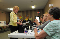 NWA Democrat-Gazette/FLIP PUTTHOFF <br /> Kimma Harper gets her ballot Tuesday Sept. 15 2015 from poll workers (seated from left) Julie Hall, Mary Dyer and Linda Fosbender at Rogers First Christian Church.