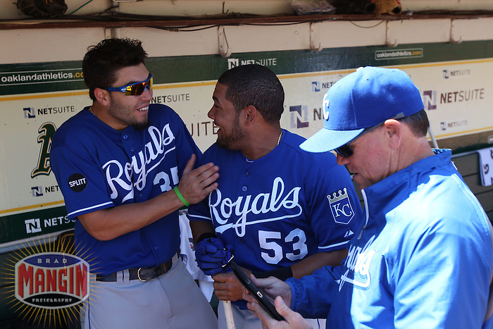 OAKLAND, CA - SEPTEMBER 5: Eric Hosmer #35 and Melky Cabrera #53 of the Kansas City Royals get ready in the dugout before the game against the Oakland Athletics at O.co Coliseum on September 5, 2011 in Oakland, California. Photo by Brad Mangin
