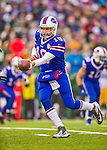 14 December 2014: Buffalo Bills quarterback Kyle Orton makes a handoff in the first quarter against the Green Bay Packers at Ralph Wilson Stadium in Orchard Park, NY. The Bills defeated the Packers 21-13, snapping the Packers' 5-game winning streak and keeping the Bills' 2014 playoff hopes alive. Mandatory Credit: Ed Wolfstein Photo *** RAW (NEF) Image File Available ***