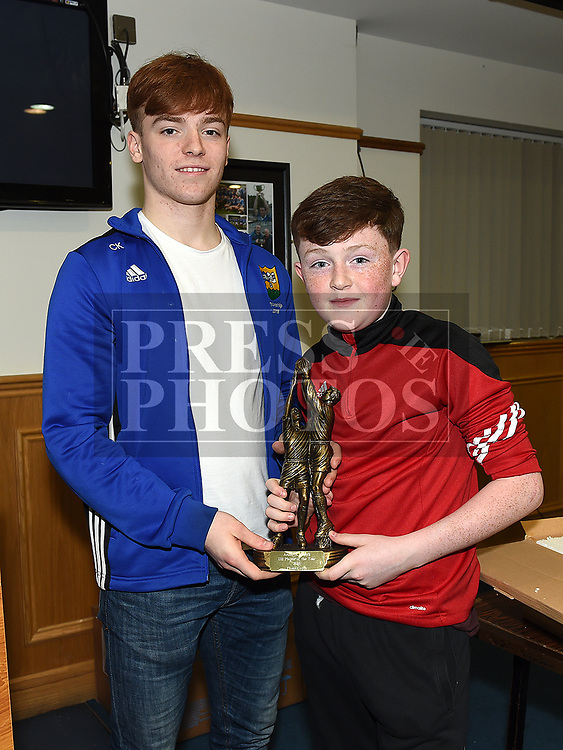 Fionn Coyle is presented with the under 11 Player of the Year award by Ciaran Keenan at the St. Mary's juvenile awards night. Photo:Colin Bell/pressphotos.ie