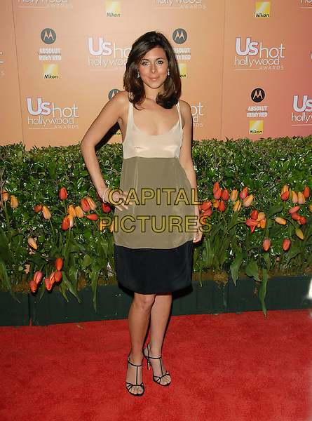 JAMIE-LYNN SIGLER.attends The US Weekly Hot Hollywood Awards held at Republiccc Restaurant & Lounge in West Hollywood, California, USA, on April 26th 2006..full length jamie lynne hand on hip black cream panelled dress.Ref: DVS.www.capitalpictures.com.sales@capitalpictures.com.©Debbie VanStory/Capital Pictures