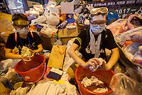 Occupy Central pro-democracy student protesters are seen wetting cloths for distribution in preparation for tear gas, on the second day of the mass civil disobedience campaign Occupy Central, Central District, Hong Kong, China, 30 September 2014. The movement is also being dubbed the 'umbrella revolution' after the versatile umbrellas used to shield protesters from rain, sun - and police pepper spray.
