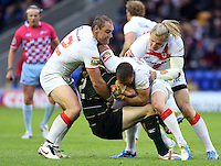 PICTURE BY VAUGHN RIDLEY/SWPIX.COM - Rugby League - 2013 International Origin - England v Exiles - Halliwell Jones Stadium, Warrington, England - 14/06/13 - England's Gareth Ellis, Kevin Sinfield and Eorl Crabtree tackle Exiles Pat Richards.