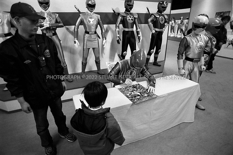 December, 2002--Kyoto, Japan..Children line up to get autographs of the 'Power Rangers...All photographs ©2003 Stuart Isett.All rights reserved.This image may not be reproduced without expressed written permission from Stuart Isett.