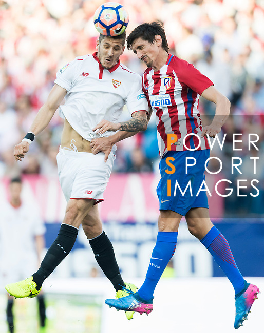 Daniel Filipe Martins Carrico (l) of Sevilla FC competes for the ball with Stefan Savic of Atletico de Madrid during their La Liga match between Atletico de Madrid and Sevilla FC at the Estadio Vicente Calderon on 19 March 2017 in Madrid, Spain. Photo by Diego Gonzalez Souto / Power Sport Images