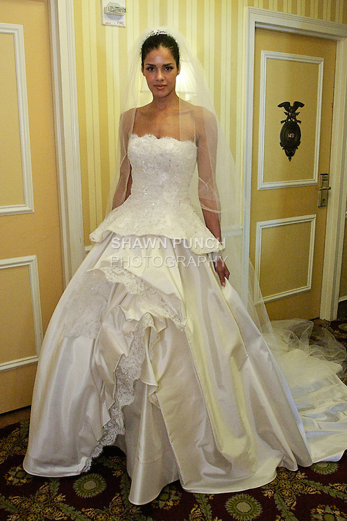 Model poses in a wedding dress with pearl white corset beaded lace, with silk mocado skirt; from Karen Sabag Spring 2012 Bridal collection, during  Couture: New York Bridal Fashion Week 2012
