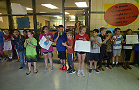 NWA Democrat-Gazette/BEN GOFF @NWABENGOFF<br /> Students line up to see off first-grader Myra Cooper and her father Staff Sgt. William Cooper of Bentonville Monday, May 8, 2017, after he surprised her in her classroom at Apple Glen Elementary School in Bentonville. Each week a parent comes in as a 'Mystery Reader' for their child's classroom at the school, with students receiving clues as to who it will be throughout the week. This week Myra was surprised by her father, who has been away from his family for over a year on deployment to Kuwait with the U.S. Army 77th Combat Aviation Brigade. Staff Sgt. Cooper read to the class from 'Harold and the Purple Crayon' by Crockett Johnson before taking Myra and the rest of their family to spend the day a the nearby Scott Family Amazeum.