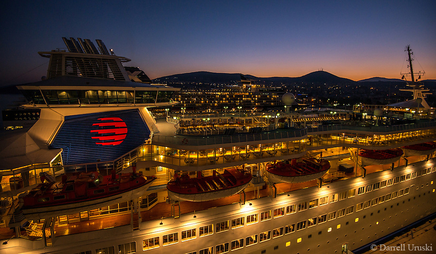 Fine Art Landscape and Travel Photograph of several cruise ships in the port of Kusadasi Turkey. The morning sun was just beginning to rise. I really liked the blue sky morning glowing behind the mountain tops, and the warm golden glow from the cruise ships.