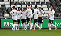Pictured: Nathan Redmond of England (3rd L) celebrating his opening goal with team mates. Monday 19 May 2014<br />