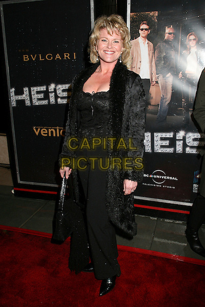 "JUDI EVANS.NBC's ""Heist"" Premiere at Rodeo Drive's Bvlgari, Beverly Hills, Californi, USA. .March 20th, 2006.Photo: Byron Purvis/AdMedia/Capital Pictures.Ref: BP/ADM.full length black coat fur collar trim.www.capitalpictures.com.sales@capitalpictures.com.© Capital Pictures."