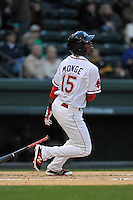 Right fielder Joseph Monge (15) of the Greenville Drive bats in a game against the Asheville Tourists on Thursday, April 7, 2016, at Fluor Field at the West End in Greenville, South Carolina. Greenville won, 4-3. (Tom Priddy/Four Seam Images)